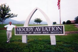 Emma with Moody Aviation sign